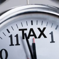 Cropped image of alarmclock showing arrival of tax time